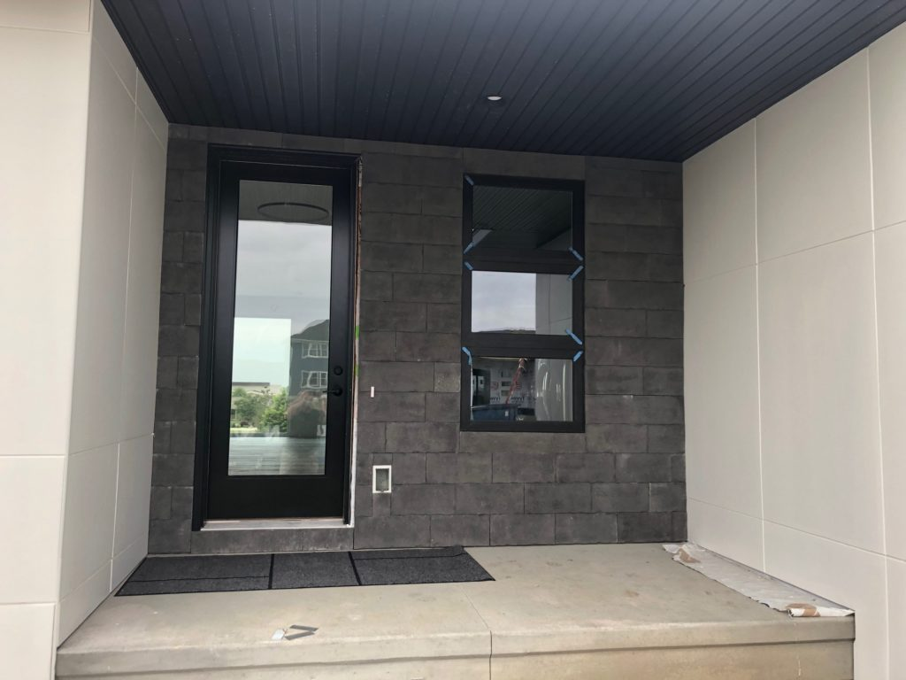 Versetta Stone Carved Block in Midnight in residential entryway