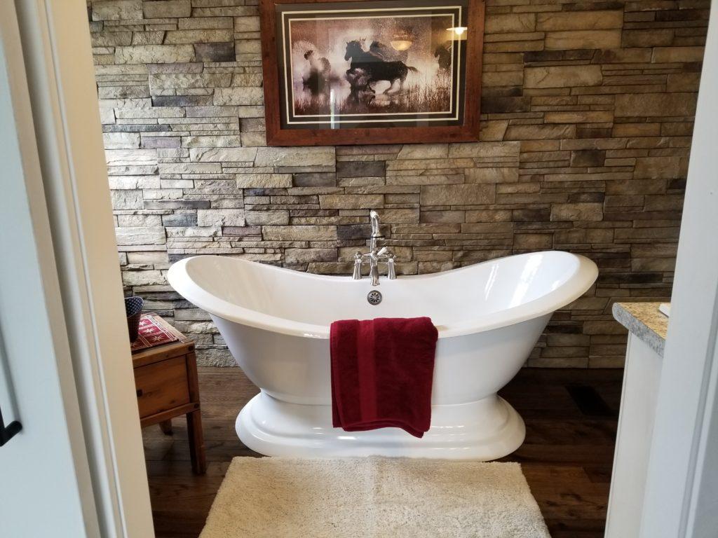 Versetta Stone stone veneer bathroom accent wall